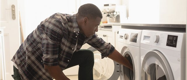 man doing his own laundry